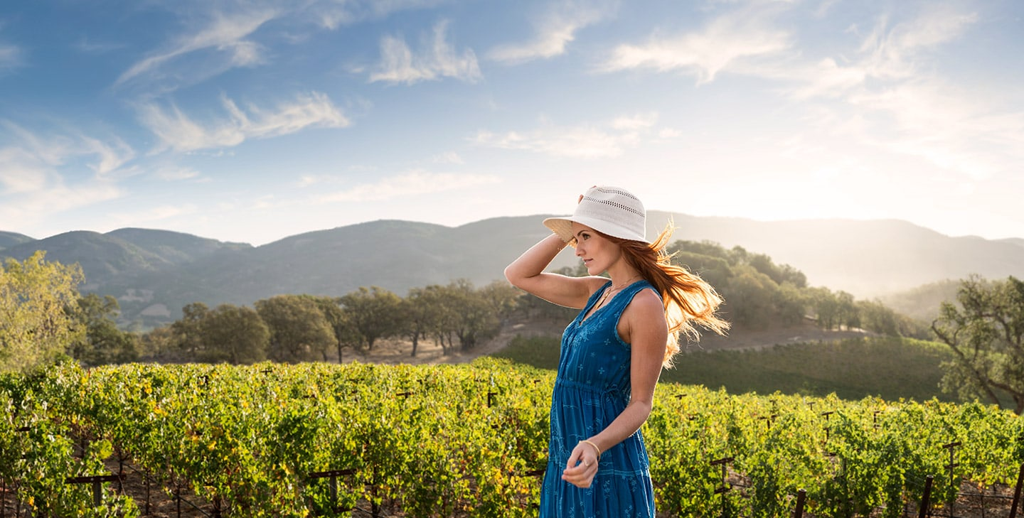 Girl_Hat_wind_blowing_hair_winery_Rod_McLean_g