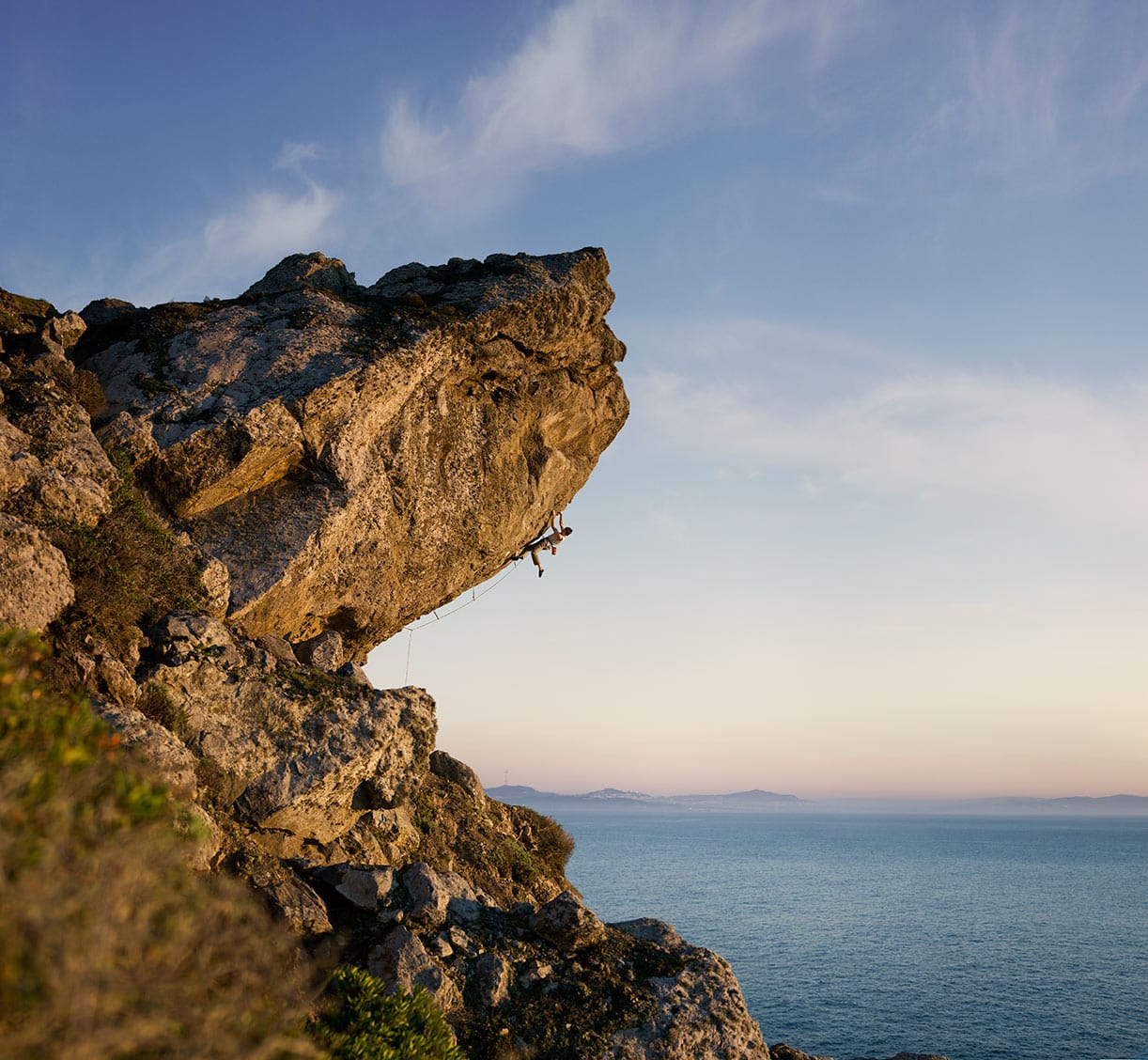Rod Mclean - man climbing rocks