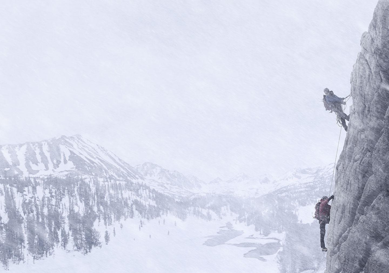 Rod Mclean - men rock climbing in the snow