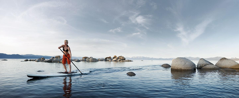 Rod Mclean - woman paddle boarding