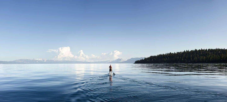 Rod Mclean - man paddling in lake tahoe