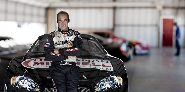 Rod Mclean - nascar driver posing by his car