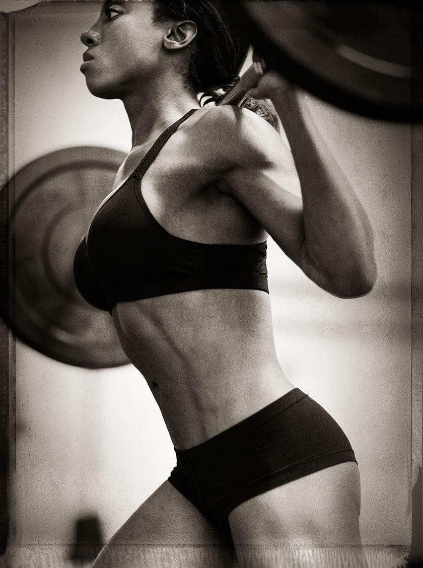 Black and White Profile Image Athlete Nicole Harris in Bikini Two Piece Doing Squats Chanel