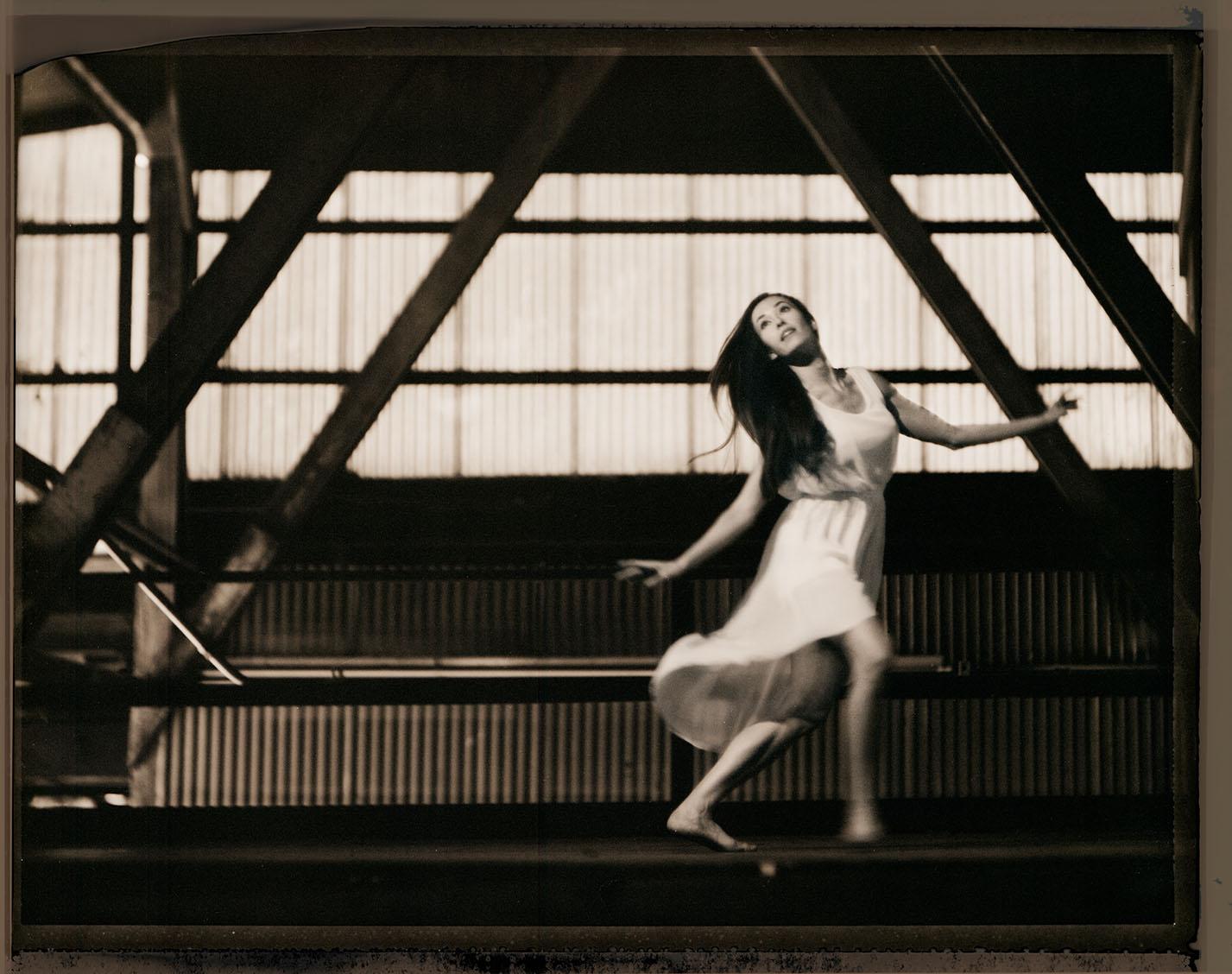 Black and White Sepia Dancer in Attitude Position Studio