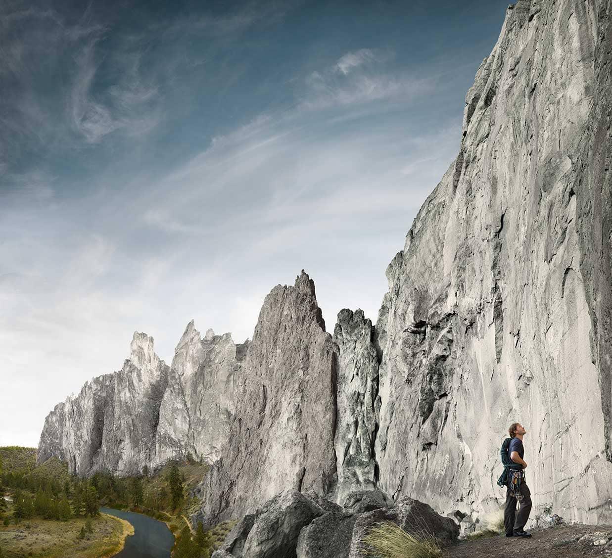 Climber Looking Up at Rock Grey Blue Skies