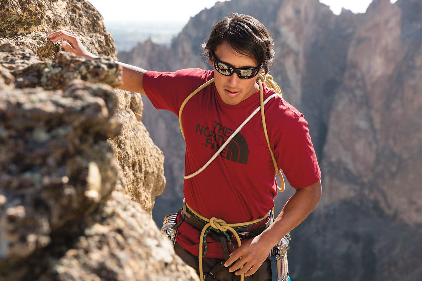 Climber NorthFace Apparel Red Shirt Sunglasses Close Up Shot