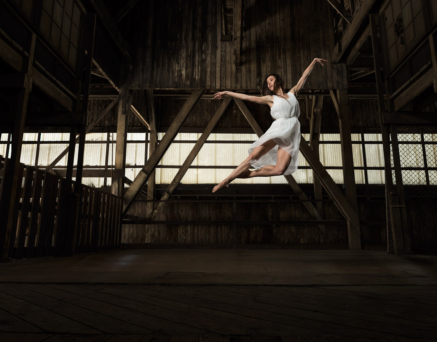 Dancer In White Profile Image of Pointe in Mid Air Jump 2