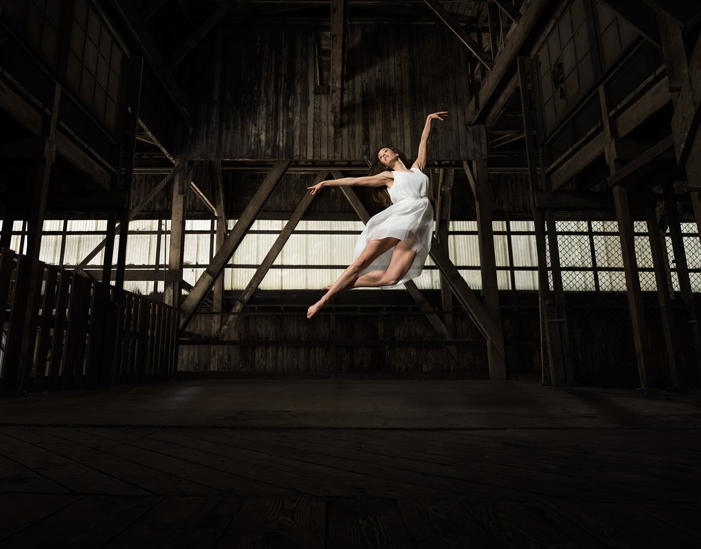 Dancer In White Profile Image of Pointe in Mid Air Jump