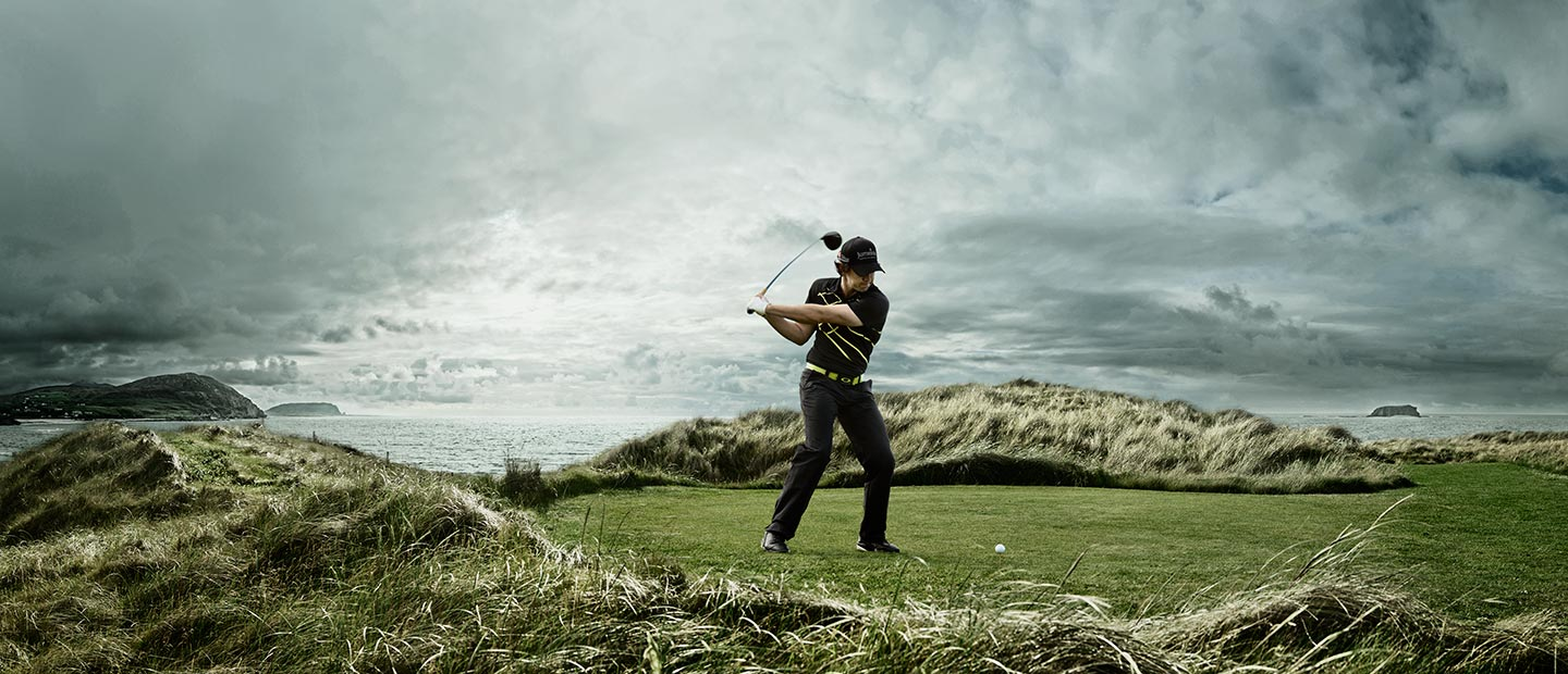 Golfer About to Swing Medium Field Shot Grey Skies