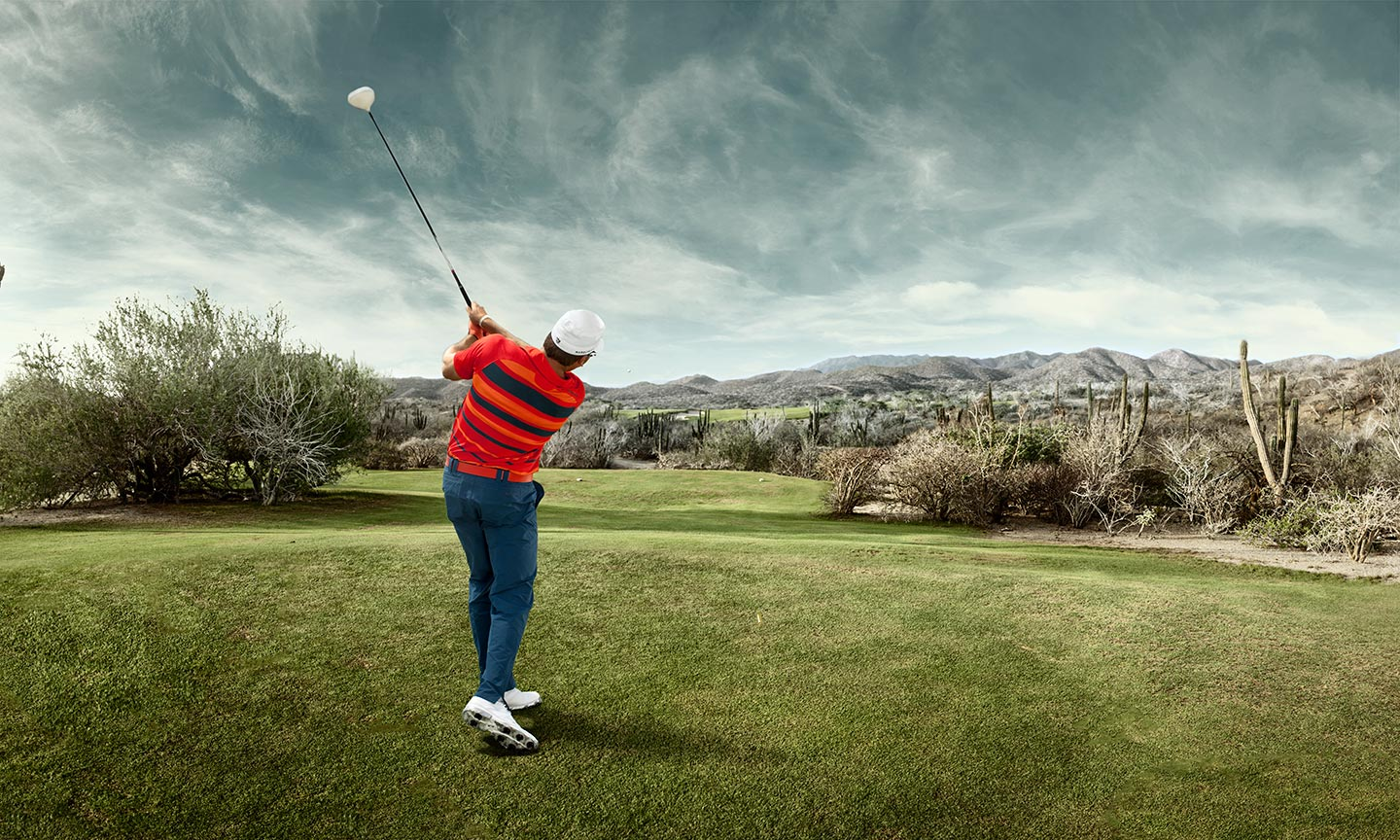 Golfer After Swing Medium Field Shot Behind Background Grey Skies