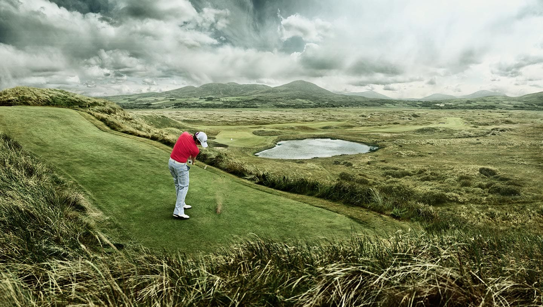Golfer Mid Swing Medium Field Shot Background Grey Skies