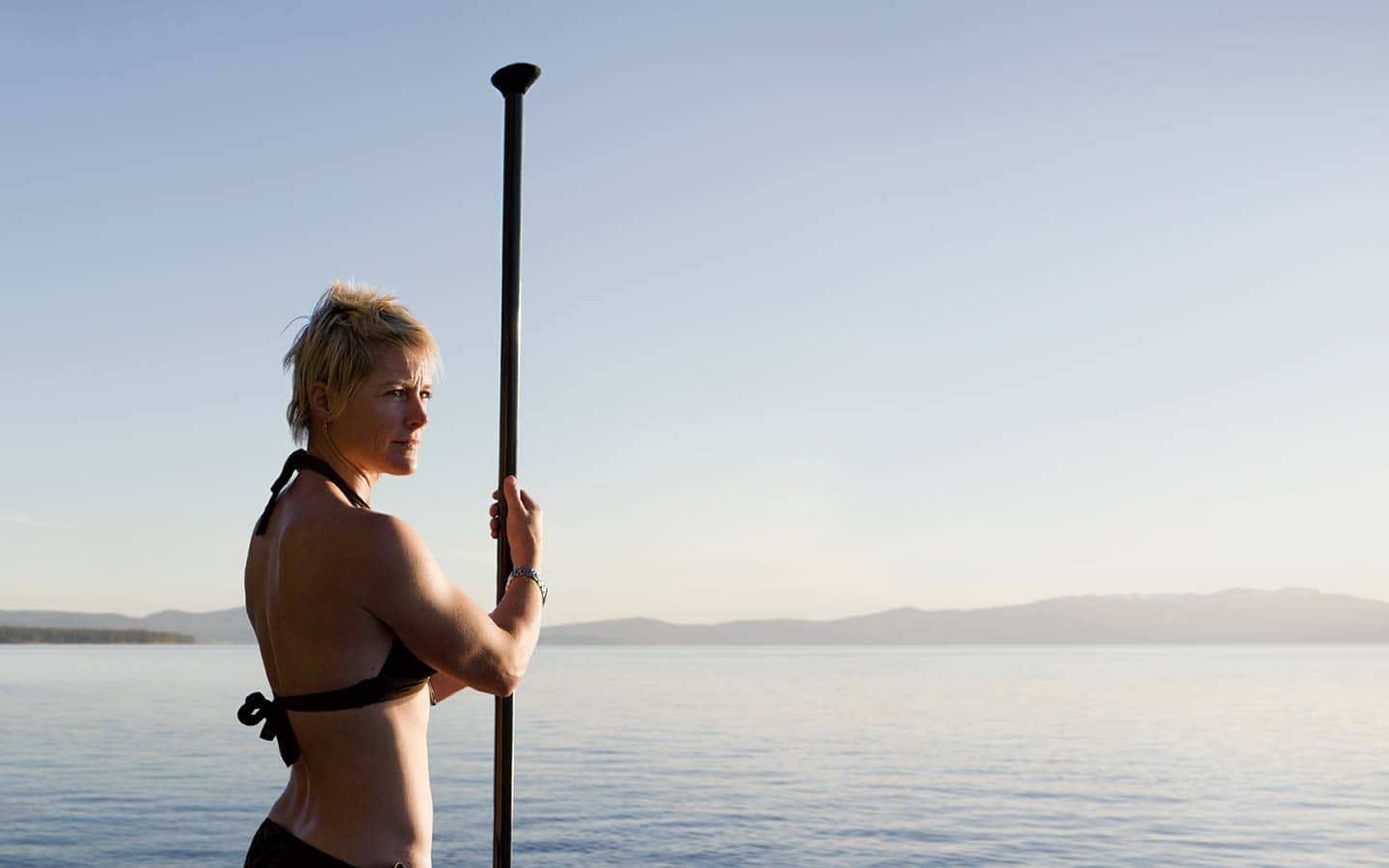 Image of Woman Holding Surf Kayaking Paddle Looking Off to Side