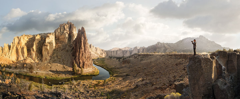 Man Taking Photo of Rocky Landscape Faraway Shot