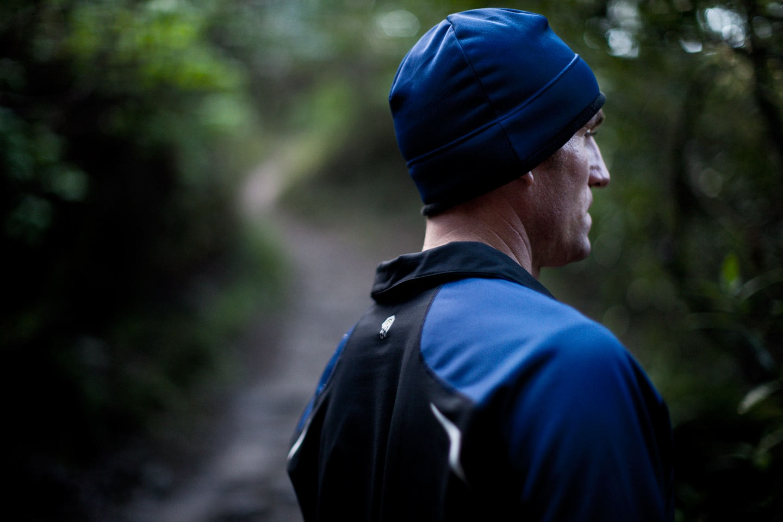 Man Wearing Blue Black Athletic Apparel Shot Behind Blurred Background Forest