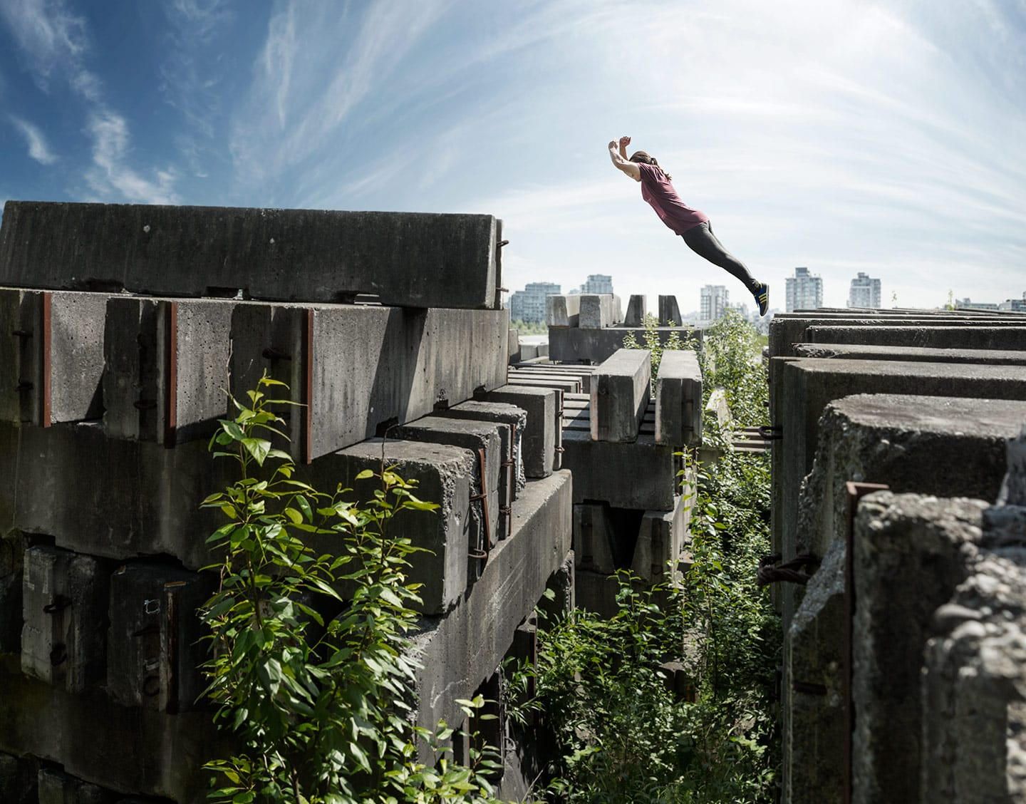 Parkour Athlete Arms Crossed Angled Jump Concrete Walls Background Bright Skies