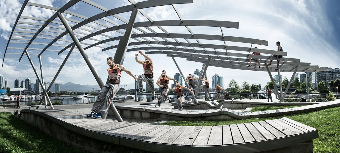 Parkour Athletes Image Running Jumping Sequence Background Against Bright Skies