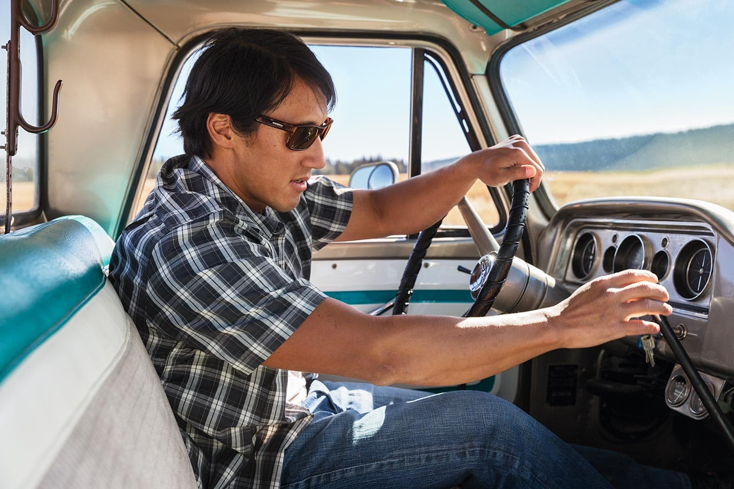 Portrait of Man in Sunglasses Driving Truck Sunny Day