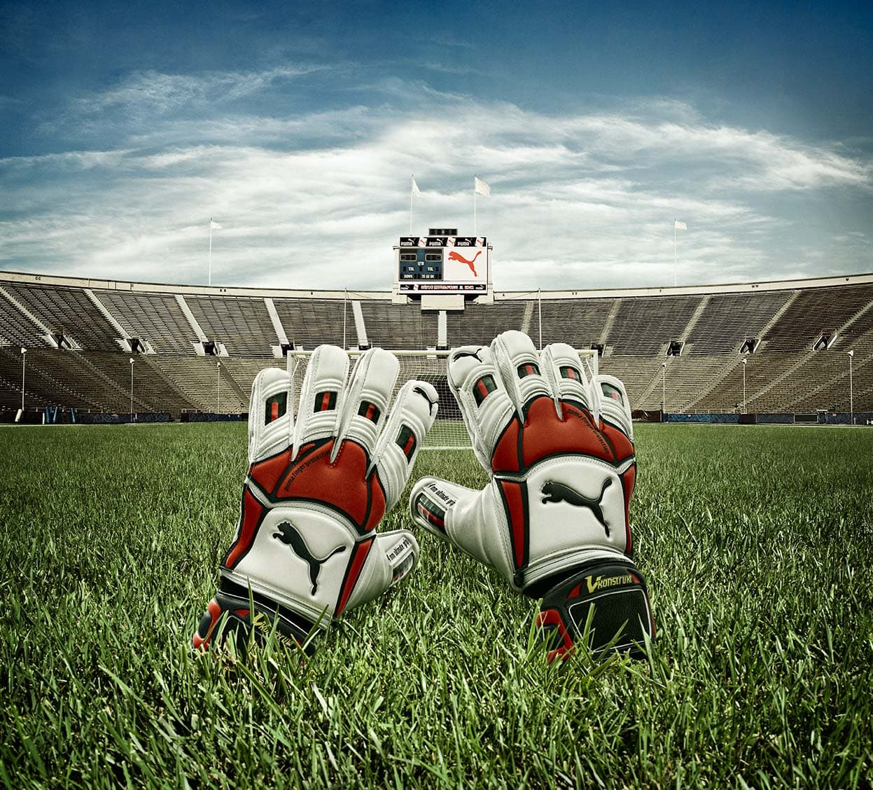 Puma Athletic White Red Black Sports Gloves Grass Facing Stadium Blue Skies