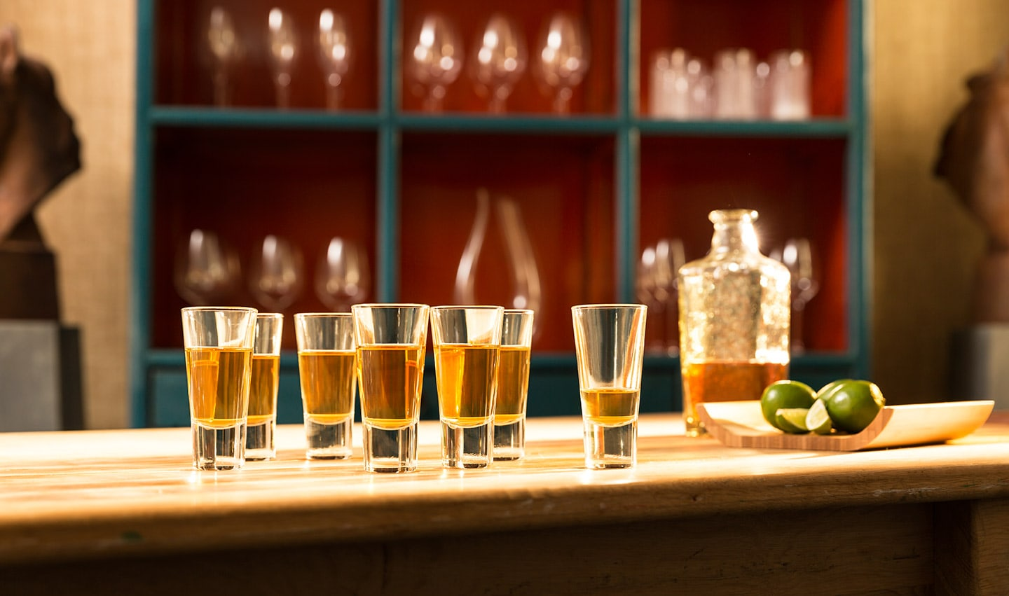 Tequila Shots and Limes on Bar Front Background Green Burgundy Square Cabinet