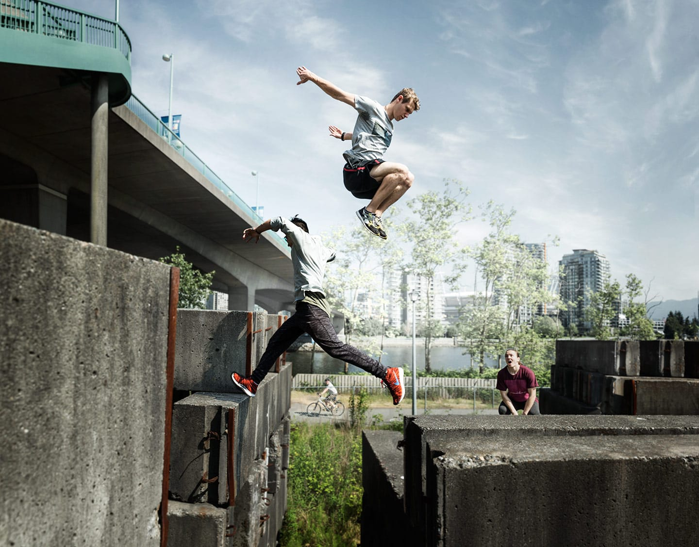Two Athletes Parkour Double Gap Jump Concrete Walls Friend Watching