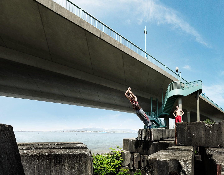 Two Athletic Men Parkour Wall Jump Gap Under Bridge