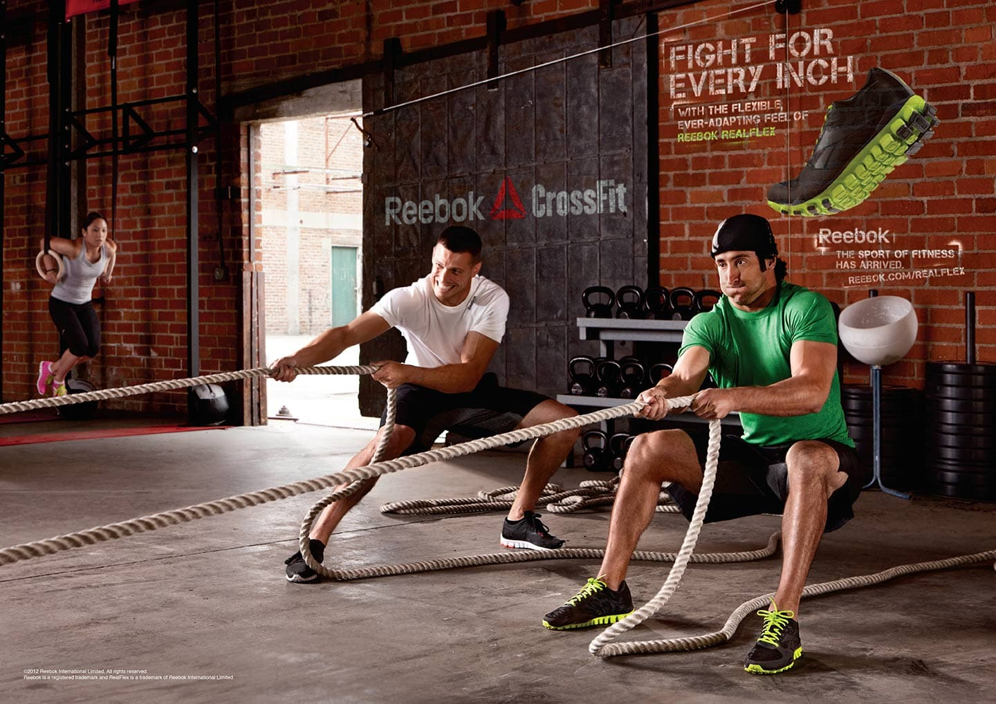 Two Men in Reebok Apparel Crossfit Workout Sled Pull