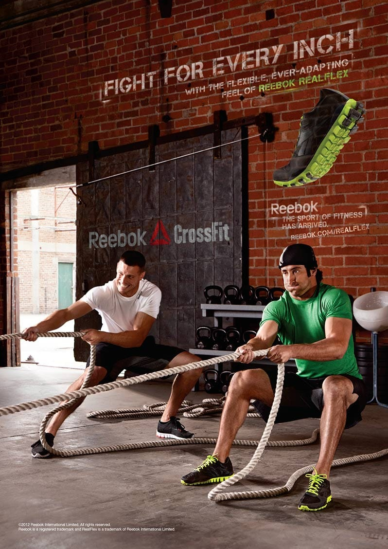 Two Men in Reebok Apparel Crossfit Workout Sled Pull Vertical