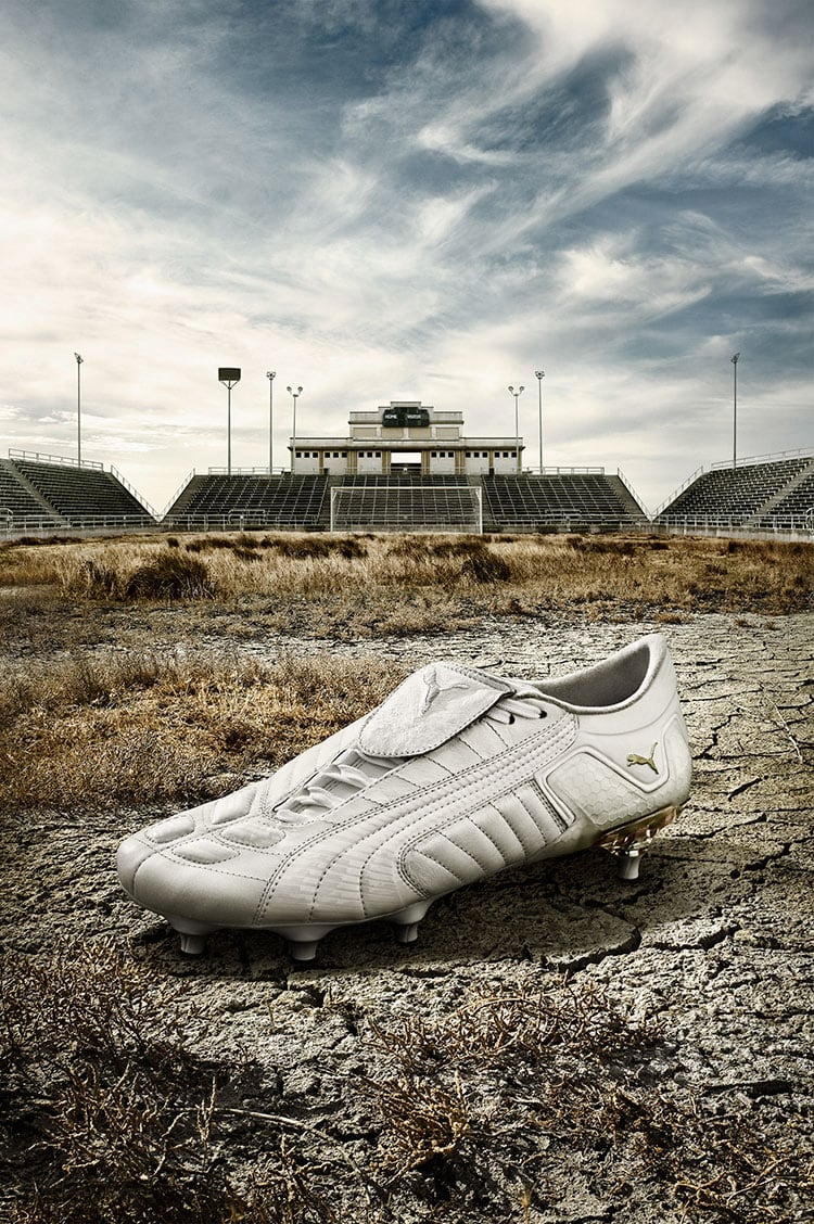 White Puma Shoe Ground Sports Stadium Background Grey Skies