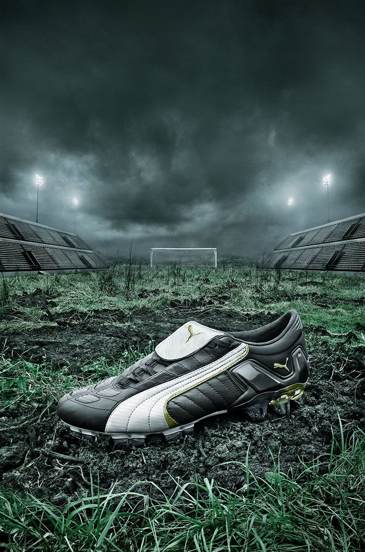 White and Black Puma Shoe Grass Stadium Background Dark Skies Bright Lights