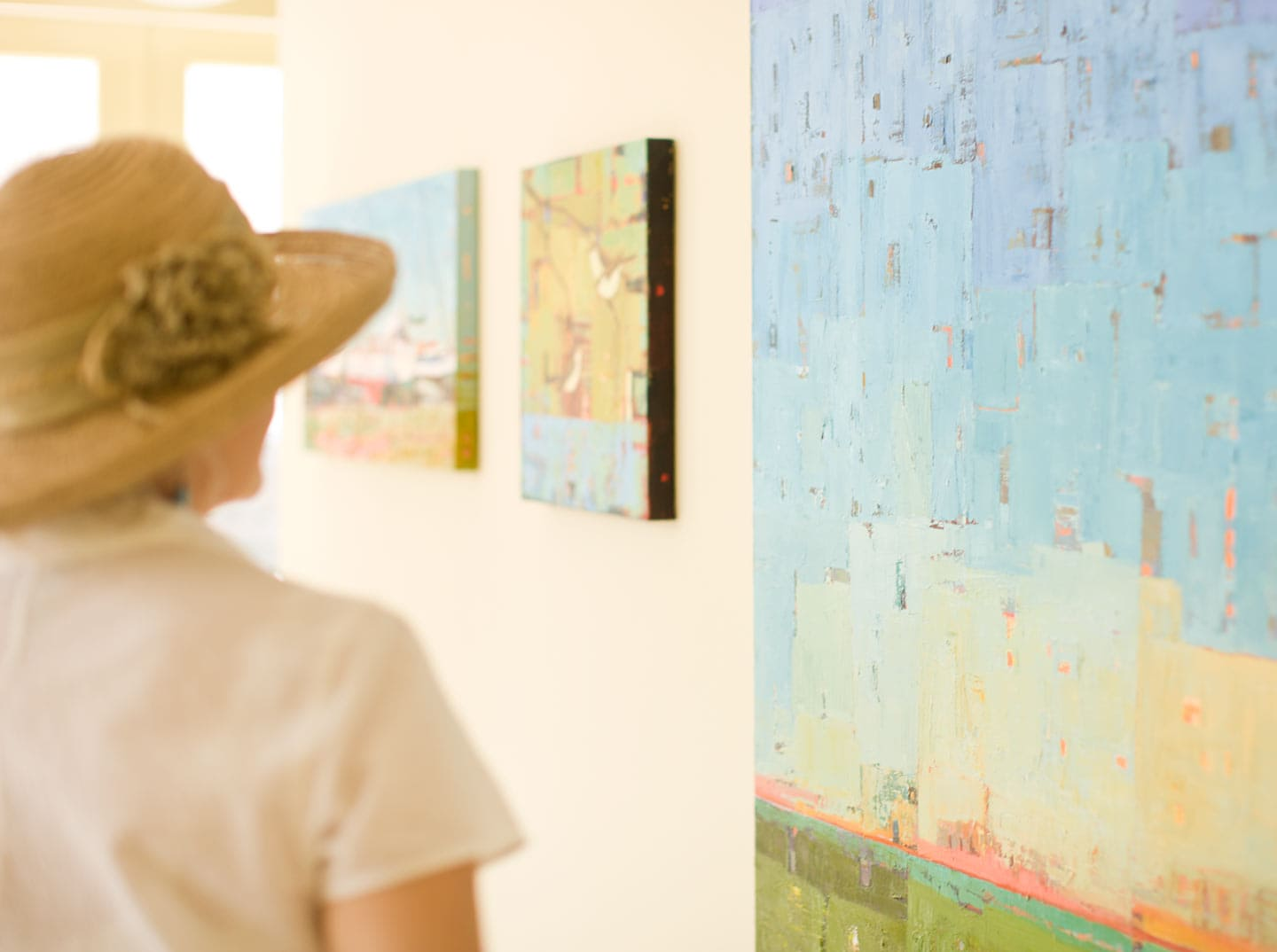 Woman in Hat Admiring Art