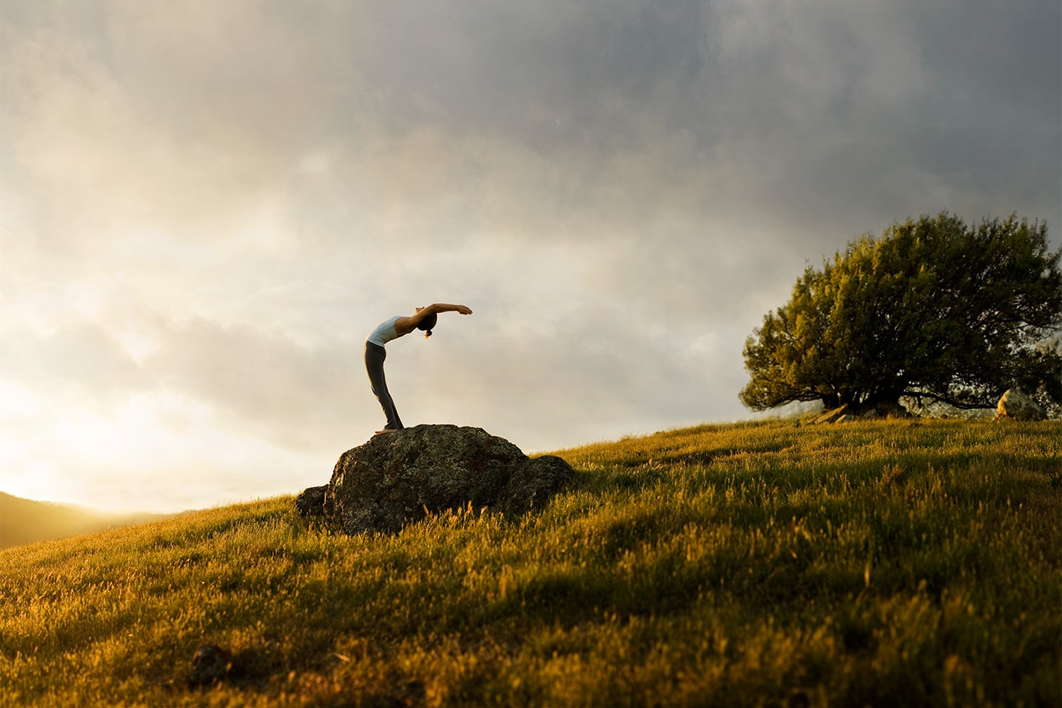 Active-Lifestyle-woman-doing-yoga-backbend-at-sunrise-RodMcLean