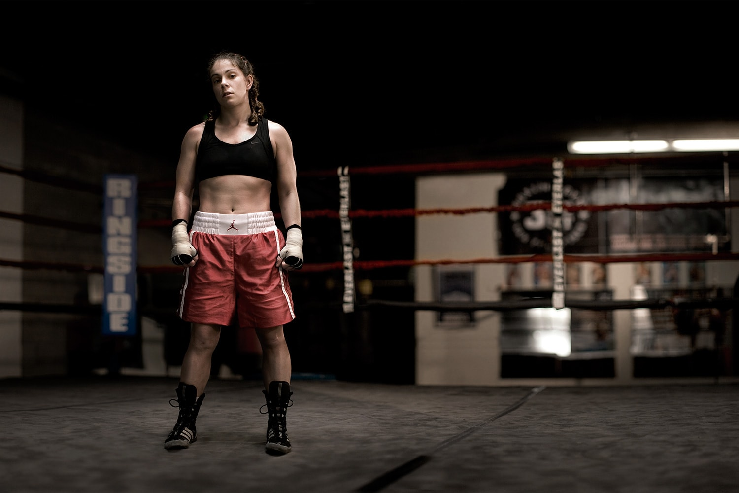 Athlete-female-boxer-standing-in-ring-Rod-McLean