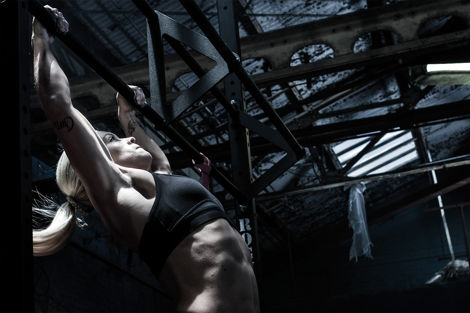 Athlete-female-doing-pull-ups-crossfit-Rod-McLean