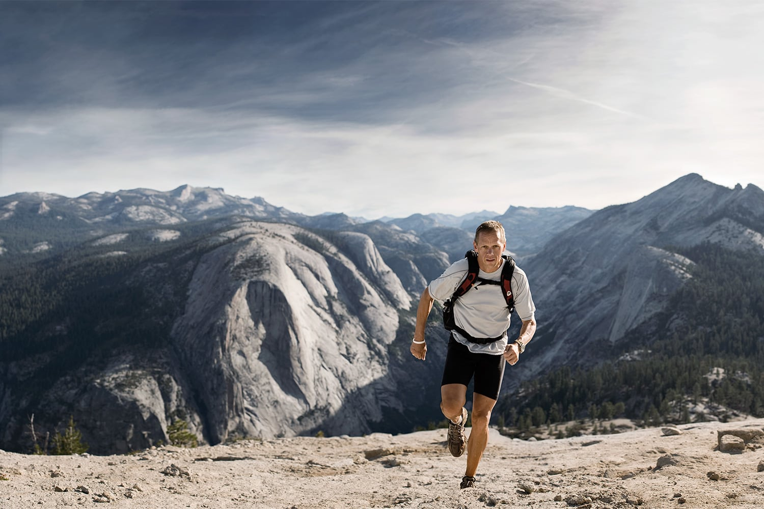 Athletic-lifestyle-man-charlie-engle-running-up-half-dome-Rod-McLean