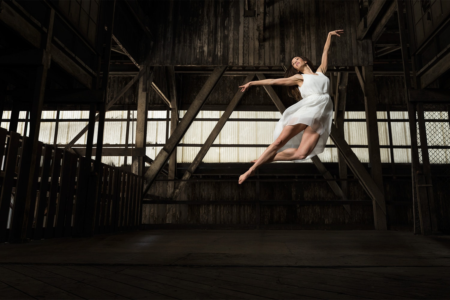 Female-Ballet-Ballerina-dancing-jumping-white-outfit-wood-warehouse-Rod-McLean