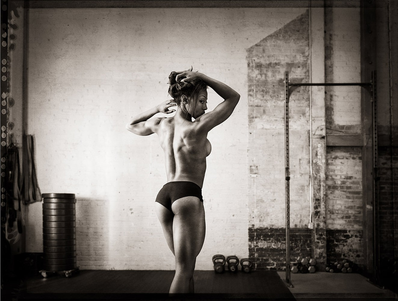 Female-athlete-working-out-flexing-in-gym-Rod-McLean