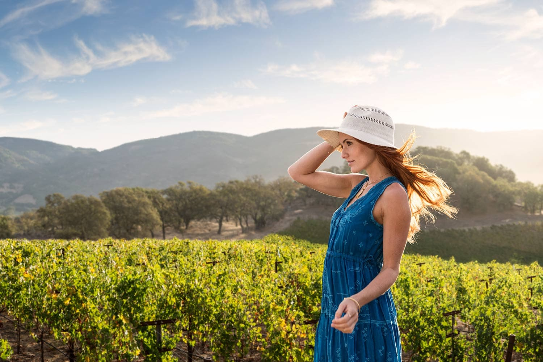 Female-with-hat-in-vineyard-wind-blowing-hair-Rod-McLean