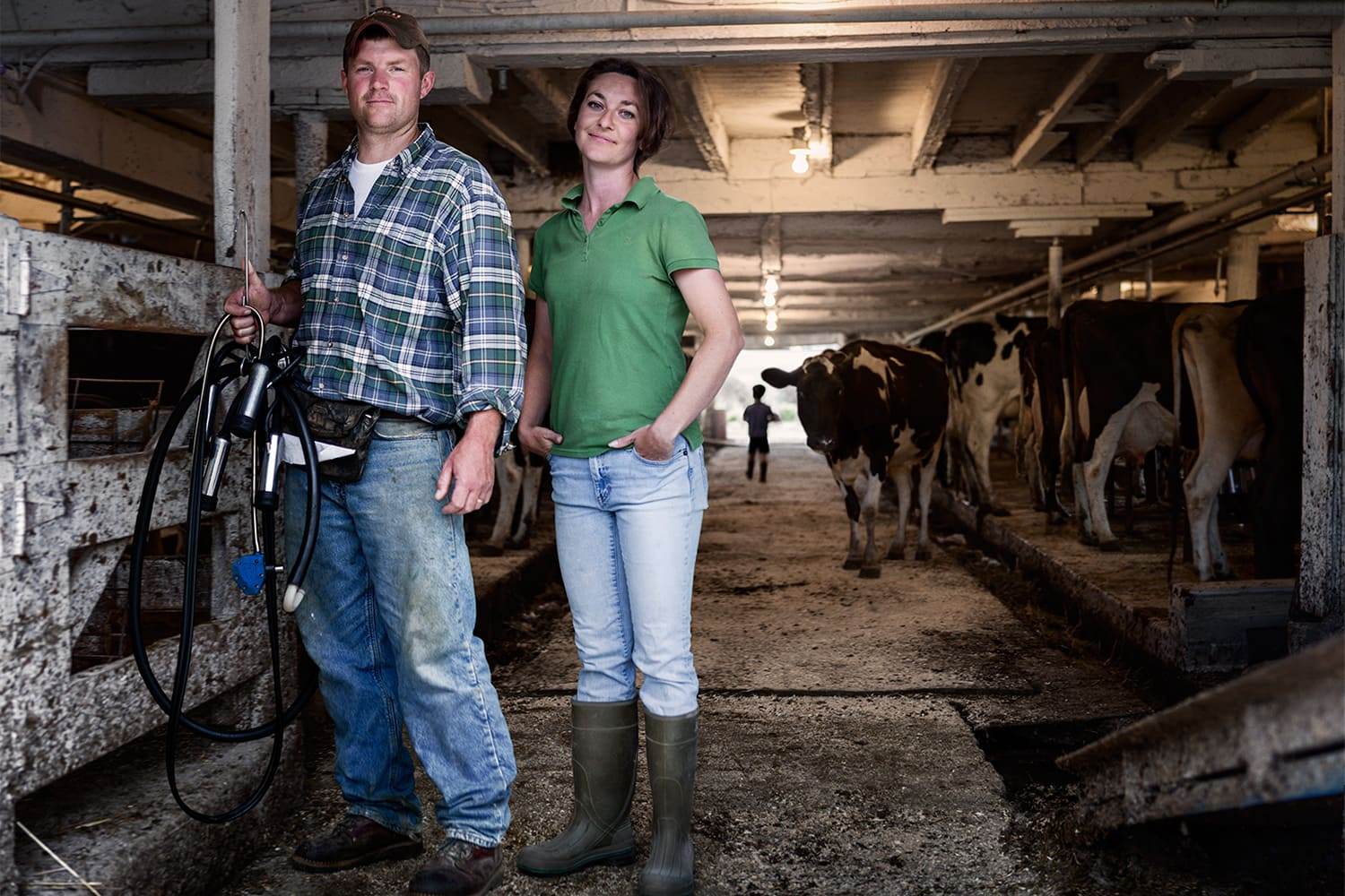 Male-Female-Dairy-Farmers-portrait-barn-with-cows-Rod-McLean