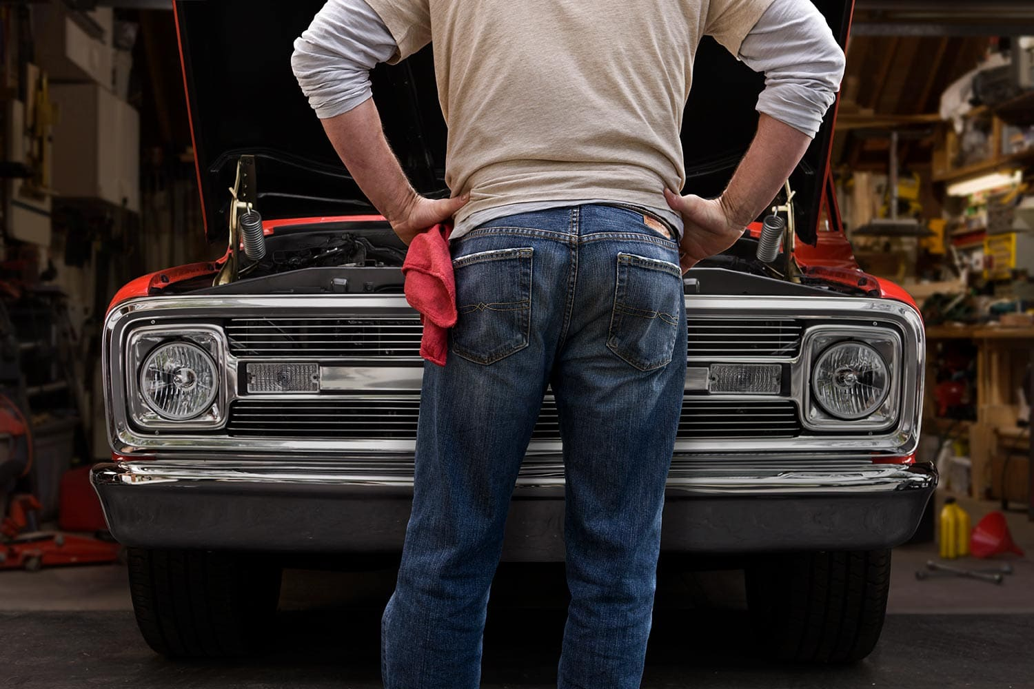 Man-fixing-red-truck-Rod-McLean