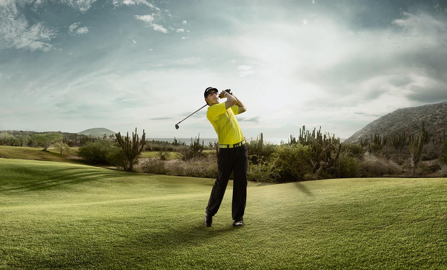 Rod-Mclean-Active-Lifestyle-male-golfer-Ricky-Barnes-swinging-iron-on-the-fairway